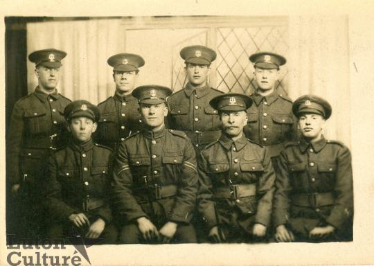 Group photograph of eight soldiers including Ronald Rootham