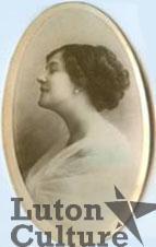 A locket shaped photograph of a woman
